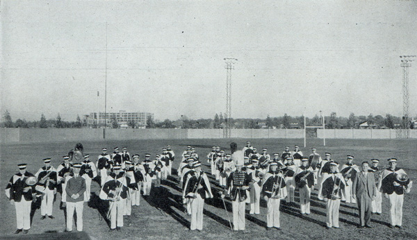 Members of the 1932-33 Marching Band stand with their instruments